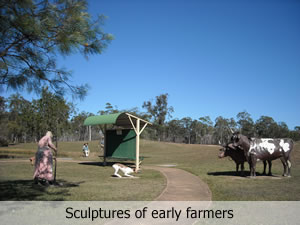 Sculptures showing farming in settler's times